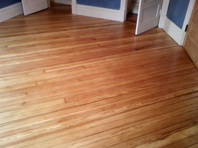 Refinished 100 year old Heart Pine wood floor in Iowa City