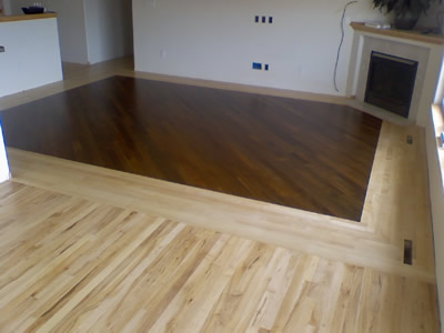 Maple border with Ipe (Brazilian Walnut) laid on the diagonal in the center in Iowa City
