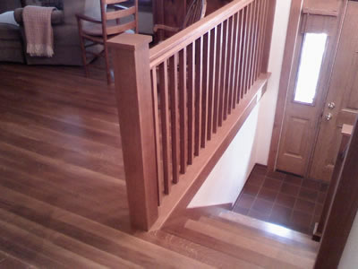 Installed 3 inch, #1 common, long length Quartersawn white oak and matching staircase and railings